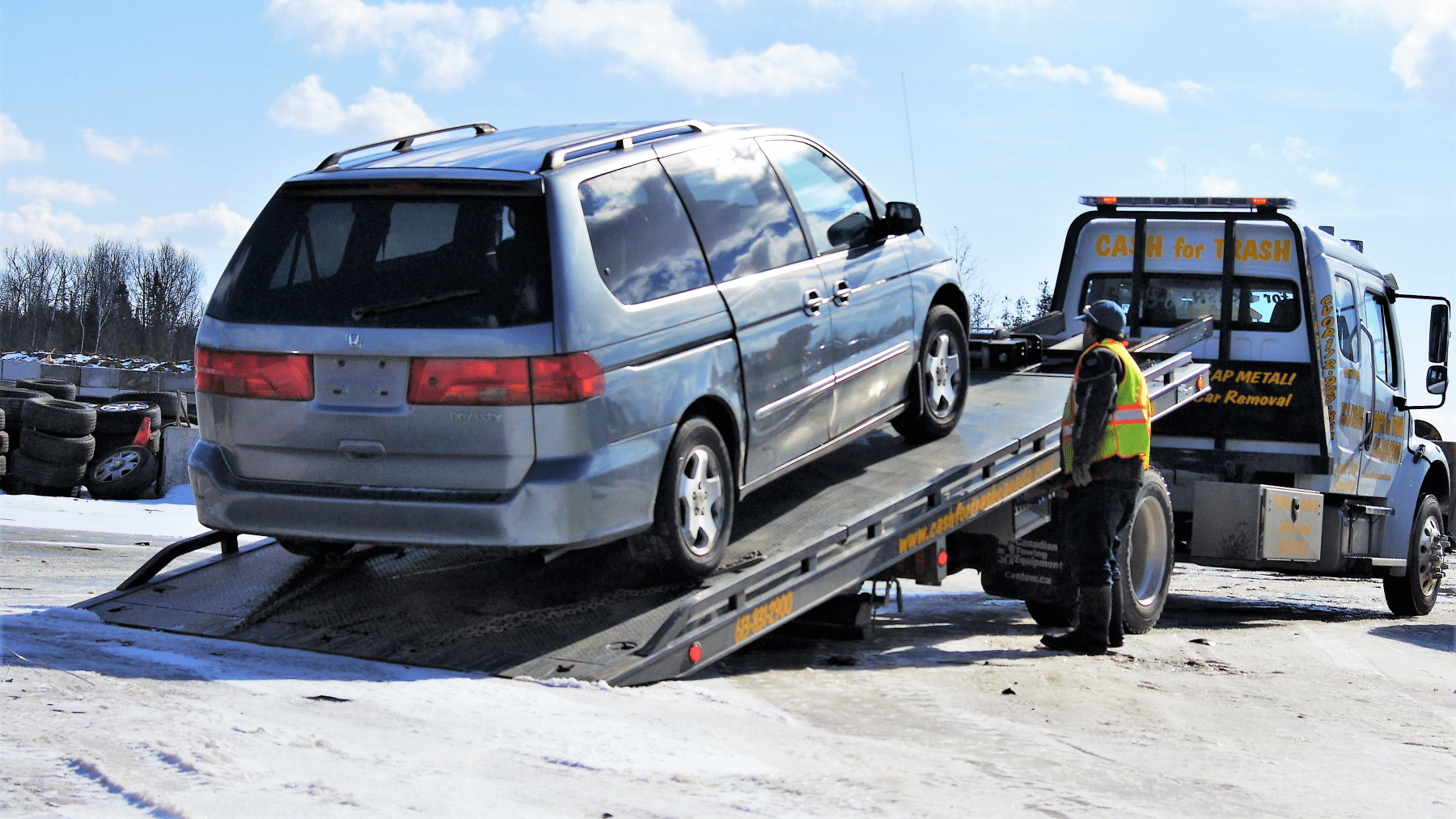Junk van being towed way for cash in Ottawa